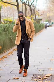 a cream pea coat and black jeans teamed together are a total eye candy for those
