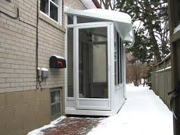 Side Door Enclosure Used As A Vestibule To A Home Office.
