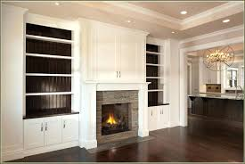 built ins around fireplace in entertainment center and beside