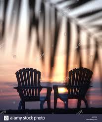 adirondack chairs on beach sunset. Exellent Chairs Adirondack Chairs Silhouetted On Palm Lined Beach At Sunset Intended Chairs On Beach Sunset A