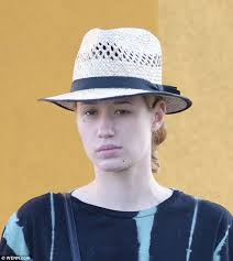 natural the 24 year old wore a straw fedora over her blonde locks