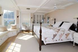 Traditional Master Bedroom with Wall sconce, Window seat, Exposed beam,  Mullion Pattern #