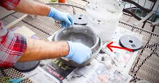 he pours wet cement into a plastic bowl to create a diy patioflame linear fire pit