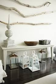 2 lighting is another decorative element which you can enhance with dry tree branches you can hang a large one above the dining table or bedhead and then