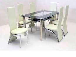 black glass dining table and 6 faux chairs in cream set