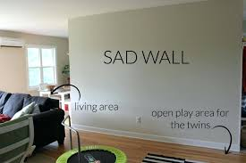 decorating an empty living room wall decor mama how to fill