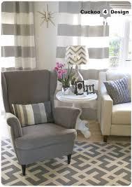 ikea strandmon chair grey horizontal striped curtains grey runner rug ikea