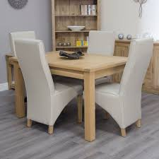 arden solid oak furniture extending dining table and four cream chairs set