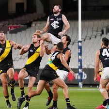 footy as AFL season makes muted bow ...