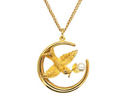 edwardian 15ct gold swallow harvest moon pendant on 9ct gold chain