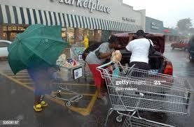 Lisa Randle, Brandy Randle, and Erica Randle load groceries at a ...