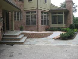 Flagstone And Brick Steps And Heated Handicap Ramp Porch