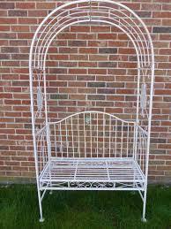 uk gardens ornate cream 2 seater metal garden bench with decorative garden arch for climbing