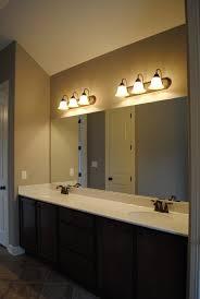 bathroom track lighting. Bathroom Cabinets Track Lighting Over Oval Within Measurements 945 X 1411 T