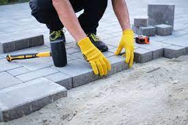 how to lay paving slabs on a slope