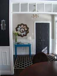 ok let s state the obvious right from the start black doors are elegant a white door would have looked charming and cote y in this entry hall