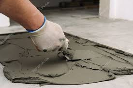 laying ceramic tiles troweling mortar concrete floor preparation laying white stock photo