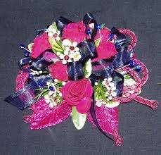 hot pink spray roses with waxflower and navy blue ribbon with hot pink ribbon and prom corsagewrist