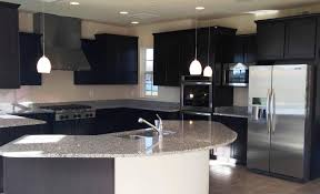 light gray granite countertop black cabinets