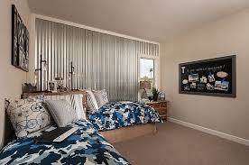 corrugated metal wall adds an interesting visual to the elegant kids bedroom design