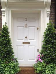 white front door topiary london