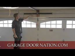 how to level a garage doorHow to Level a Garage Door to Make It Balance  YouTube