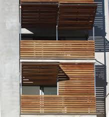 wooden louvered shutter protecting balcony 213