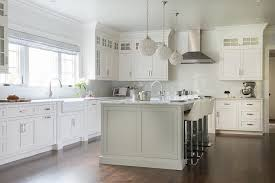 light gray kitchen island with white leather bar stools