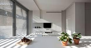 minimalist modern white house with less ornament sliding glass door design white kitchen island white