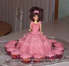 Beautiful Pink Barbie Doll Birthday Cake Idea With Cupcakes