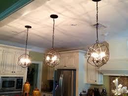 image result for black orb chandelier over kitchen island
