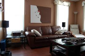 ... Fascinating Black Living Room Chair Photos Ideas Furniture Nice Artwork  Portray Wall Decor Over Seat Brown ...