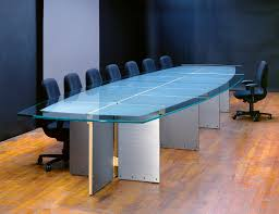 quadrant conference table with a boat shape patterned scratched glass top and maple trim