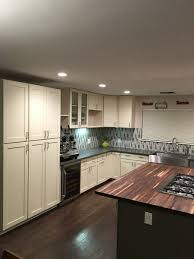 cream green shaker cabinets butcher block island counter