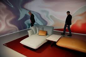italy furniture brands. Visitors Look At Furniture In The Cassina Exhibit This Year\u0027s Milan Fair. Italy Brands A