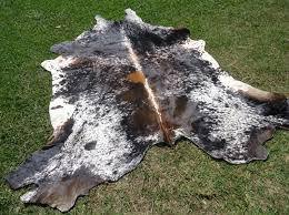 how are cowhide rugs made