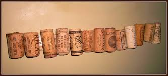 this would be really cool as a chair rail all the way across a wall but this is just a short version i cut wine corks in half and glued them to