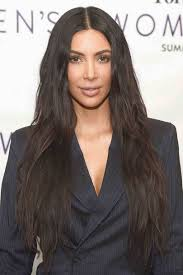 after months of wearing her hair in an ultra sleek style kim opted for a more relaxed tousled wave at an event recently