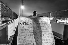 the battle in sexual violence in america s military is a  heartbreaking melissa bania holds a banner on the foot bridge across from the entrance to