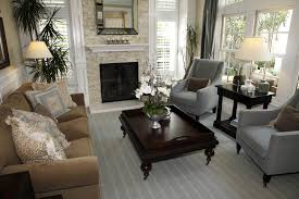 grey and brown furniture. traditional living room design with ornate dark wood coffee table two blue grey armchairs and brown furniture a