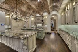 mediterranean kitchen design luxury kitchen with arched brick ceiling off white cabinetry and crystal chandeliers mediterranean style kitchen cabinets