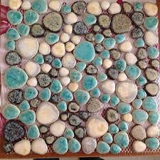 glazed porcelain tiles pebble tile green and brown shower wall and floor tiles design heart