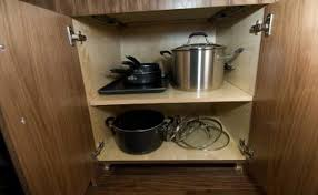 add pull out shelves to reach items in the back of your cabinet