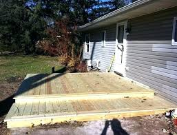 building a floating deck on concrete post building a floating deck over a concrete patio