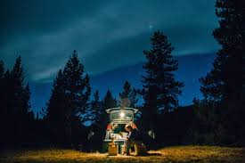 camping in the woods at night. Man Cooking A Meal At Campsite In Canada Camping The Woods Night