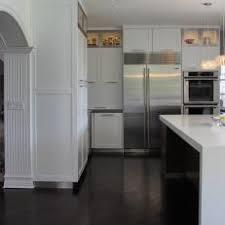 Dark hardwood floors kitchen Small Apartment Transitional White Kitchen With Dark Hardwood Floors Idaho Interior Design Photos Hgtv