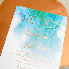 we just love the way these wedding invitations feature a unique beach themed design for a modern seaside soiree
