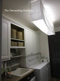 Outstanding black white laundry room ideas Washer Dryer Outstanding Laundry Room Design With Lighting Fixtures Charming Design For Laundry Room Decoration With Rectangular Groliehome Laundry Room Lovely White Laundry Room Decoration Using Round White