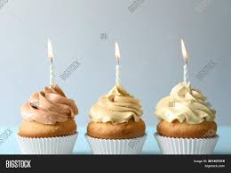Delicious Birthday Cupcakes With Candles On Light Image Cg2p61407218c