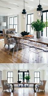 industrial lights and wood table and clear ghost chairs in dining room via h2 design and build